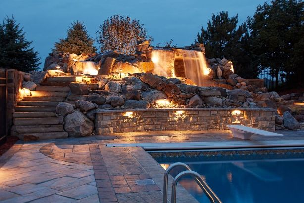 elite landscaping specializes in natural stone waterfalls and grottos for outdoor living spaces